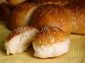 Tasty buns with sesame on napkin  background