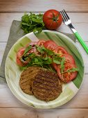 foto of hamburger-steak  - soy steak with arugula and tomatoes salad - JPG