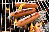 stock photo of grilled sausage  - BBQ sausages on fire in the grill - JPG