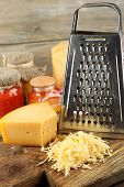 pic of grating  - Grated cheese on wooden background - JPG