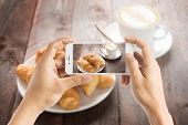 picture of croissant  - Taking photo of fresh baked croissants and coffee on wood table - JPG