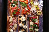 pic of sandwich  - Different sandwiches with vegetables and cheese on pan close up - JPG