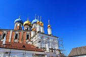 pic of scaffolding  - Orthodox church with golden domes in scaffolding for restoration - JPG