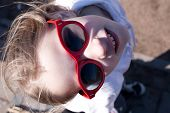 stock photo of cheater  - closeup portrait of cool young girl in big sunglasses - JPG