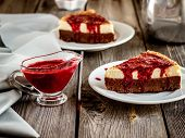 picture of cheesecake  - cheesecake with cherry sauce in vintage style on wooden table - JPG