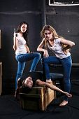 stock photo of killing  - Two young women killed man by bat and gun on basement - JPG