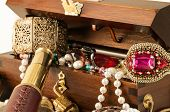 foto of treasure  - Pirate treasure chest with pearls jewels coins and glass