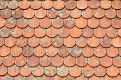 stock photo of roof tile  - Old red clay house roof tiles background - JPG