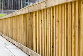 pic of lumber  - New treated pine lumber railings on the side of a bridge - JPG