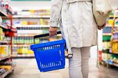 stock photo of grocery store  - Pretty young woman buying groceries in a supermarket - JPG