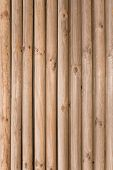 foto of log fence  - Natural background pattern of a log wall - JPG