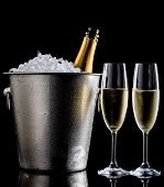 image of flute  - Champagne bottle inside ice bucket and two champagne flutes - JPG
