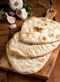 stock photo of cilantro  - Delicious fresh homemade naan bread with garlic and cilantro.