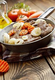 picture of liver fry  - Liver fried with carrot and onion in a frying pan - JPG