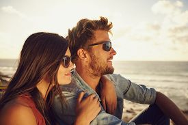 picture of couple  - Beautiful young couple together outdoors on a summer day - JPG