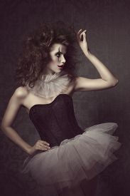 stock photo of gothic hair  - stunning vintage masquerade portrait of sensual brunette woman with vintage gothic tutu clown make - JPG