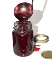 picture of jar jelly  - a laddle pouring jelly into a jar - JPG