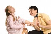 picture of tickle  - mom tickling daughter on white background laughing - JPG