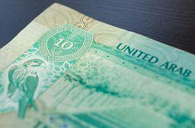 picture of dirham  - Ten dirhams of the United Arab Emirates close up - JPG