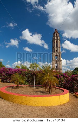 poster of Manaca Iznaga old slavery tower near Trinidad Cuba. The Manaca Iznaga Tower is the tallest lookout tower ever built in the Caribbean sugar region.