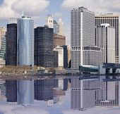 Lower end of Manhattan with reflection as seen from New York Harbor.