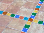 image of bordure  - mexican terracotta flagstones with a colorful bordure - JPG