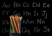 pencil crayons with chalkboard background