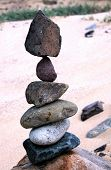 Six Stones In Precarious Balance In The Beach