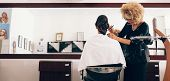Female Hair Stylist Working On A Woman s Hair At Salon poster