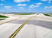 Airplanes on airport taxiway.