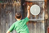 Boy Playing Darts Outdoor