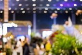 People In Expo Exhibition Hall, Public Event, Business Trade Show.  Blur Image For Abstract Backgrou poster