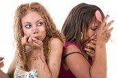 image of bulimic  - Two attractive women sitting back to back and eating too much - JPG