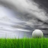 High resolution 3d white golf ball in green grass on a gray sky with clouds