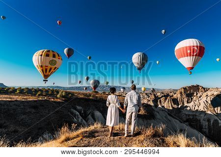 poster of Wedding Travel. Honeymoon Trip. Couple In Love Among Balloons. A Guy Proposes To A Girl. Couple In L