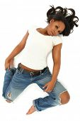 Attractive Young Sexy Black Woman in Jeans and Shirt Laying on White Floor