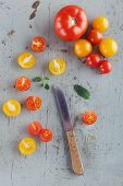 Red And Yellow Tomatoes On Rustic Table