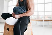 Muscular Tired Man Resting On Box And Hold Towel In Hand. Perspiring Fit Athlete Relaxing In Sport G poster