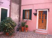 Pastel colored home on Burano, the lace-making island off the coast of Venice, Italy
