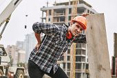 Hard Work. Construction Worker In Protective Helmet Feeling Back Pain While Working At Construction  poster