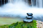 Pebble stones over waterfall