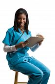 stock photo of medical chart  - An isolated shot of an african american nurse writing on health chart - JPG
