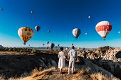Wedding Travel. Honeymoon Trip. Couple In Love Among Balloons. A Guy Proposes To A Girl. Couple In L poster