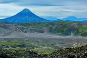 One Of The Volcanoes Of Kamchatka. Volcanoes Of Kamchatka Are Fascinating. Their Mysteriousness Attr poster