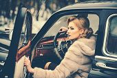 Sexy Woman In Fur Coat. Call Girl In Vintage Car. Travel And Business Trip Or Hitch Hiking. Retro Co poster