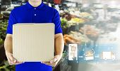 Delivery Man Hand Holding Paper Box In Blue Uniform For Delivering Package And Icon Media On Store B poster