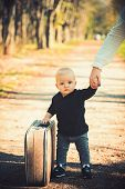 Child Traveler Carry Vintage Bag With Mothers Hand, Childhood. Child Travel With Retro Suitcase On N poster