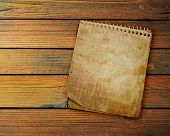 old used notebook on a wooden background