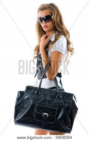 Постер, плакат: Мода модель с большой мешок, холст на подрамнике