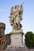 One Of Bernini`s Statue Of Angels On Ponte Sant`angelo, In Front Of Castel Sant`angelo In Rome